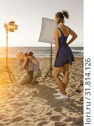 Купить «photographer shooting female model on seaside», фото № 31814126, снято 5 октября 2018 г. (c) Яков Филимонов / Фотобанк Лори
