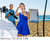 Купить «Young attractive female model delighted with professional photo shooting on seaside with male photographer», фото № 31814134, снято 5 октября 2018 г. (c) Яков Филимонов / Фотобанк Лори