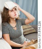 Купить «Woman with wet towel on her forehead», фото № 31814226, снято 24 февраля 2020 г. (c) Яков Филимонов / Фотобанк Лори