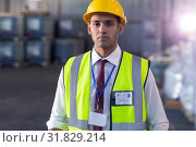 Купить «Male staff in hardhat and reflective jacket standing in warehouse», фото № 31829214, снято 23 марта 2019 г. (c) Wavebreak Media / Фотобанк Лори