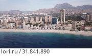 Купить «Panoramic view of resort sand coast and buildings of city Benidorm, Spain», видеоролик № 31841890, снято 17 апреля 2019 г. (c) Яков Филимонов / Фотобанк Лори