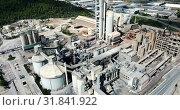 Industrial background with large cement factory. Aerial view. Стоковое видео, видеограф Яков Филимонов / Фотобанк Лори