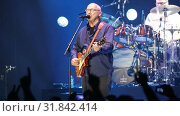 Купить «Mark Knopfler during performance at Palau Sant Jordi, Barcelona», видеоролик № 31842414, снято 26 апреля 2019 г. (c) Яков Филимонов / Фотобанк Лори
