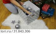 Купить «Women's hands lay Christmas toys on a fur rug», видеоролик № 31843306, снято 25 ноября 2018 г. (c) Aleksandr Sulimov / Фотобанк Лори