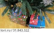 Купить «Christmas gifts under the snow branches ate», видеоролик № 31843322, снято 25 ноября 2018 г. (c) Aleksandr Sulimov / Фотобанк Лори