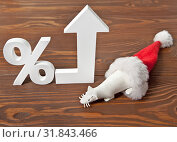 Купить «White rat out of the hood of Santa Claus next to a sign of interest and an up arrow. Holiday discounts are growing.», фото № 31843466, снято 19 августа 2019 г. (c) Элина Гаревская / Фотобанк Лори