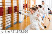 Купить «Sports group of athletes at fencing workout», фото № 31843630, снято 30 мая 2018 г. (c) Яков Филимонов / Фотобанк Лори