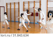 Купить «Happy group practicing fencing techniques», фото № 31843634, снято 30 мая 2018 г. (c) Яков Филимонов / Фотобанк Лори