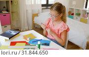 Купить «creative girl making greeting card at home», видеоролик № 31844650, снято 21 июля 2019 г. (c) Syda Productions / Фотобанк Лори