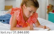 Купить «little girl drawing in sketchbook at home», видеоролик № 31844690, снято 21 июля 2019 г. (c) Syda Productions / Фотобанк Лори