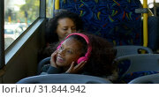 Купить «Girl listening music on headphones while travelling in bus 4k», видеоролик № 31844942, снято 10 июня 2018 г. (c) Wavebreak Media / Фотобанк Лори