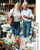 Купить «Mature family couple choosing vintage dishes on street market», фото № 31845278, снято 11 мая 2019 г. (c) Яков Филимонов / Фотобанк Лори