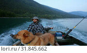 Купить «Fishermen travelling with his dog in the boat 4k», видеоролик № 31845662, снято 30 июля 2018 г. (c) Wavebreak Media / Фотобанк Лори