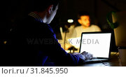 Купить «Male executive using laptop at desk in office 4k», видеоролик № 31845950, снято 25 августа 2018 г. (c) Wavebreak Media / Фотобанк Лори