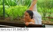 Купить «Female ballerina doing stretching exercise on the bench 4k», видеоролик № 31845970, снято 26 сентября 2018 г. (c) Wavebreak Media / Фотобанк Лори