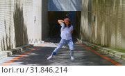 Купить «Dancer practicing dance on asphalt road 4k», видеоролик № 31846214, снято 26 сентября 2018 г. (c) Wavebreak Media / Фотобанк Лори