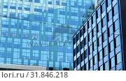 Купить «Modern glass buildings in the city 4k», видеоролик № 31846218, снято 22 сентября 2018 г. (c) Wavebreak Media / Фотобанк Лори