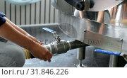 Female worker checking a pipe in distillery factory 4k. Стоковое видео, агентство Wavebreak Media / Фотобанк Лори