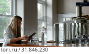Купить «Female worker using digital tablet in distillery factory 4k», видеоролик № 31846230, снято 29 августа 2018 г. (c) Wavebreak Media / Фотобанк Лори