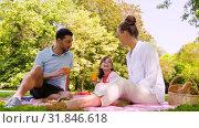 happy family drinking juice on picnic at park. Стоковая анимация, видеограф Syda Productions / Фотобанк Лори