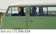 Купить «Beautiful woman looking through van window 4k», видеоролик № 31846834, снято 20 сентября 2018 г. (c) Wavebreak Media / Фотобанк Лори