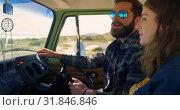 Купить «Beautiful woman pointing finger showing something to man in car 4k», видеоролик № 31846846, снято 20 сентября 2018 г. (c) Wavebreak Media / Фотобанк Лори