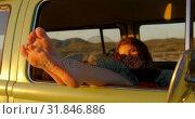 Купить «Woman legs out of the van window during sunset 4k», видеоролик № 31846886, снято 20 сентября 2018 г. (c) Wavebreak Media / Фотобанк Лори