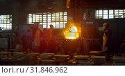 Купить «Workers melting metal in foundry workshop 4k», видеоролик № 31846962, снято 27 сентября 2018 г. (c) Wavebreak Media / Фотобанк Лори