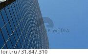 Купить «Modern glass buildings in the city 4k», видеоролик № 31847310, снято 24 сентября 2018 г. (c) Wavebreak Media / Фотобанк Лори