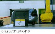 Купить «Close-up of robotic remote control in warehouse 4k», видеоролик № 31847410, снято 4 октября 2018 г. (c) Wavebreak Media / Фотобанк Лори