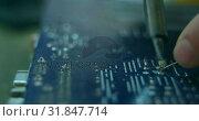 Купить «Close-up of robotic engineer assembling circuit board at desk 4k», видеоролик № 31847714, снято 4 октября 2018 г. (c) Wavebreak Media / Фотобанк Лори