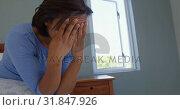 Купить «Side view of mature Caucasian woman sitting on bed with hand on forehead in comfortable home 4k», видеоролик № 31847926, снято 7 ноября 2018 г. (c) Wavebreak Media / Фотобанк Лори