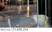 Купить «Front view of beautiful caucasian businesswoman working on laptop in a modern hotel 4k», видеоролик № 31848254, снято 14 октября 2018 г. (c) Wavebreak Media / Фотобанк Лори