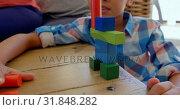 Купить «Front view of little mixed-race boy playing with toys on table in a comfortable home 4k», видеоролик № 31848282, снято 7 ноября 2018 г. (c) Wavebreak Media / Фотобанк Лори