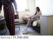 Купить «Young woman dressing white socks in shared bedroom», фото № 31848806, снято 8 февраля 2019 г. (c) age Fotostock / Фотобанк Лори