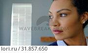 Купить «Front view of young mixed-race woman looking away in a comfortable home 4k», видеоролик № 31857650, снято 7 ноября 2018 г. (c) Wavebreak Media / Фотобанк Лори