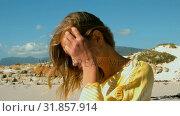 Купить «Side view of young Caucasian woman relaxing on the beach 4k», видеоролик № 31857914, снято 6 ноября 2018 г. (c) Wavebreak Media / Фотобанк Лори