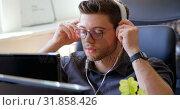 Купить «Front view of young caucasian businessman wearing headset and working at desk in a modern office 4k», видеоролик № 31858426, снято 6 октября 2018 г. (c) Wavebreak Media / Фотобанк Лори