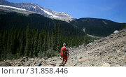 Купить «Rear view of young caucasian male hiker with backpack hiking on mountain 4k», видеоролик № 31858446, снято 16 июля 2018 г. (c) Wavebreak Media / Фотобанк Лори