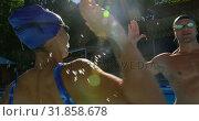 Купить «Couple giving high five in swimming pool 4k», видеоролик № 31858678, снято 10 ноября 2018 г. (c) Wavebreak Media / Фотобанк Лори