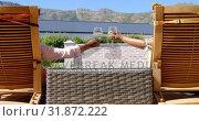 Купить «Rear view of black senior couple relaxing on pool deck chair in back yard of their home 4k», видеоролик № 31872222, снято 7 ноября 2018 г. (c) Wavebreak Media / Фотобанк Лори