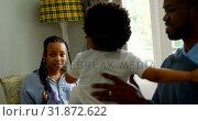 Купить «Side view of young black father playing with his son in living of comfortable home 4k», видеоролик № 31872622, снято 19 октября 2018 г. (c) Wavebreak Media / Фотобанк Лори