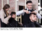 Купить «Male hairdresser cutting hair of male client», фото № 31879790, снято 5 марта 2018 г. (c) Яков Филимонов / Фотобанк Лори