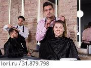 Купить «Man hairdresser discussing hairstyling with female client», фото № 31879798, снято 5 марта 2018 г. (c) Яков Филимонов / Фотобанк Лори