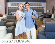 Купить «Family is satisfied by buying new sofa», фото № 31879846, снято 19 июня 2017 г. (c) Яков Филимонов / Фотобанк Лори