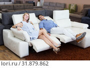Купить «Couple who are choosing new sofa-transformer», фото № 31879862, снято 19 июня 2017 г. (c) Яков Филимонов / Фотобанк Лори