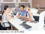 Купить «couple are consulting about a colors of sofa.», фото № 31879866, снято 19 июня 2017 г. (c) Яков Филимонов / Фотобанк Лори