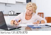 Купить «Woman filling up documents», фото № 31879870, снято 11 июля 2018 г. (c) Яков Филимонов / Фотобанк Лори