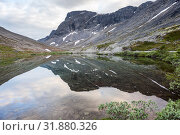 Купить «Calm surface of mountain lake with reflection, Khibins mountains in Kola Peninsula, Russia», фото № 31880326, снято 18 июля 2015 г. (c) Кекяляйнен Андрей / Фотобанк Лори