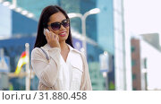 Купить «smiling asian woman calling on smartphone in city», видеоролик № 31880458, снято 21 июля 2019 г. (c) Syda Productions / Фотобанк Лори